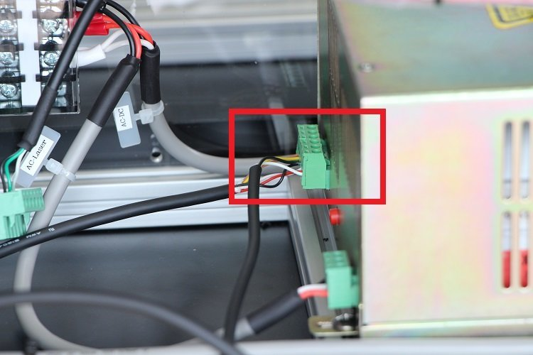 connecting the button for optical axis adjustment to laser power