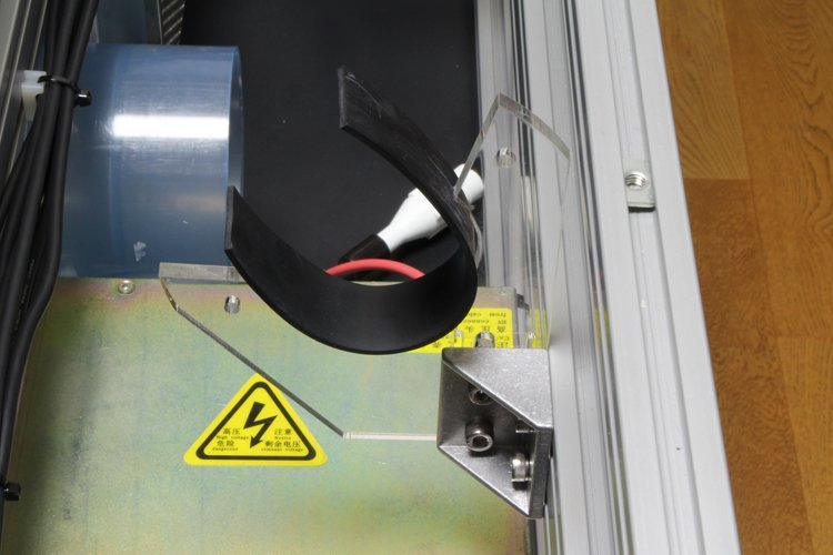 putting rubber sheet on laser tube support under